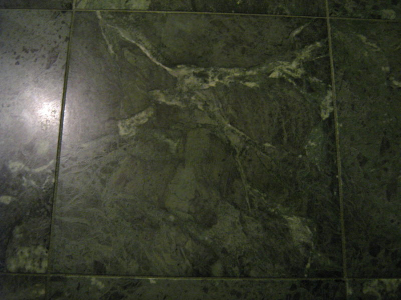Green marble tiles cleaned and restored